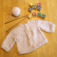 """""""This sweet little baby sweater makes a cute gift and it really can be completed in 5 hours (yes, I timed it!). This pattern has been passed along in different forms for many years and I've added some of my own updates to simplify it."""""""