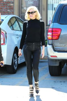 There's A Simple Formula Behind Gwen Stefani's Best Outfits  #refinery29  http://www.refinery29.com/2015/03/84103/gwen-stefani-best-outfits#slide-6  When in doubt, channel a movie icon. Gwen gave her best Sandy Olsson in a form-fitting, all-black ensemble. Tell me about it, stud.Gwen is wearing J Brand jeans, L.A.M.B. shoes, and Prada sunglasses. For a similar style, try: