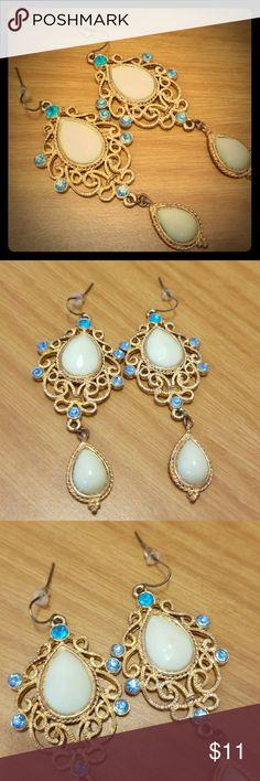 Earrings Nwot . Never worn. Gold plated metal. Jewelry Earrings