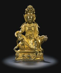 A lacquer-gilt bronze figure of Guanyin, Late Ming dynasty