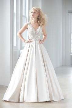 2e20419e65ea Madison James Bridal Sheer side panels on the bodice give this regal satin  ballgown added edge.