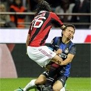 You only get harsh tackles lin this in Serie A     Mario Yepes of AC Milan and Yuto Nagatomo of FC Inter Milan (R)