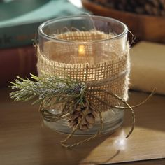 Set the mood with our Burlap and Pine Votive Candle Holder. Just add a candle and its rustic accents with add a charming, peaceful glow to any space.
