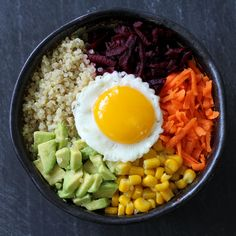This looks easy and delicious!   1/2 cup of cooked quinoa (or rice)  1 small beet, peeled and grated  1 small carrot, peeled and grated  1/3 cup of sweet corn  half an avocado, cut into small chunks  1 egg  red chili paste (kimchi)  coconut oil  liquid aminos (wheat-free soy substitute)