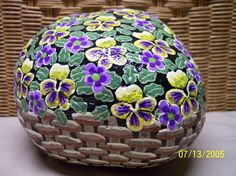 Flower basket painted on a rock. By Linda Hallett