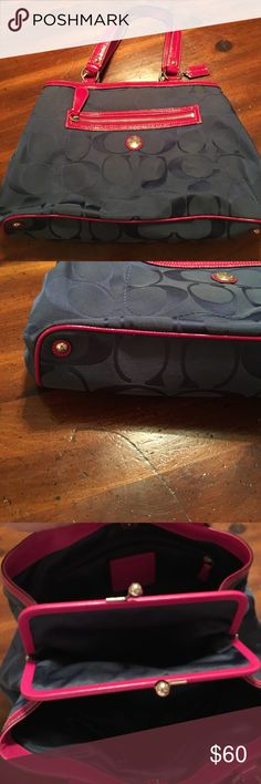 Authentic Coach bag Hot pink and navy Coach bag. It has plenty of pockets inside the bag and also a coin purse in the middle with silver knots to close Coach Bags Shoulder Bags