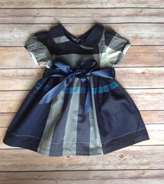 This adorable dress is very comfortable. It is made out of 100% navy cotton plaid fabric. It has a cute Peter Pan collar, and is finished with