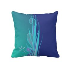 Deep Sea Floral Imagine being in a deep sea garden, surrounded by waving plant fronds, with the tropical sunlight streaming down, turning the water vibrant and glorious shades of blue. Perfect for a tropical ocean theme in any coastal home decor.