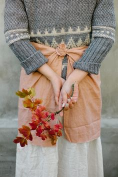 The girl is holding a twig of autumn burgundy leaves Bell Sleeves, Bell Sleeve Top, Autumn Garden, Hold On, Burgundy, Seasons, Tops, Leaves, Stock Photos