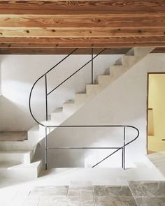 Concrete staircase with tubular railing