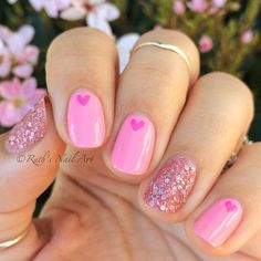 Pink love heart nail art.