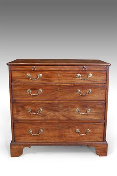 Lovely quality small Georgian golden mahogany chest of drawers. Moulded top with brushing slide, over four long cockbeaded drawers fitted with original brass swan neck handles. Raised on shaped bracket feet. Antique Bedside Tables, Antique Bedroom Furniture, Georgian Furniture, Antique Wardrobe, Antique Chest, Brushing, Chest Of Drawers, Swan, Rooms