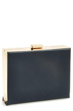This gorgeous gold and navy box clutch is sophisticated and elegant for prom.
