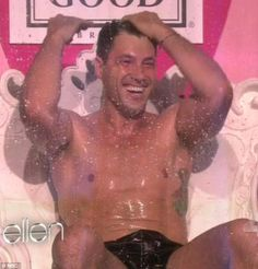 Time to get wet! Maksim Chmerkovskiy stripped to his pants and was soaked in gunge for a charity stunt on The Ellen DeGeneres Show on Thursday....way to look out for the boobies Maks!!!