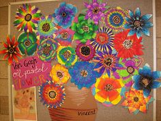 Van Gogh bulletin board. Each student makes a flower to add to the vase. Beautiful!