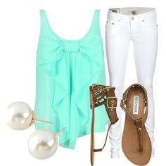 Blue tank with bow white skinny jeans and peral earings with a tan flip flop