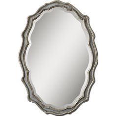 This curvaceous mirror features a frame finished in aged slate blue, and is accented with antiqued silver leaf details and a light grey wash. This stunning accent piece is sure to add depth to any room.