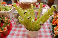 Grape caterpillars (or worms) - green grapes, skewers, white frosting, mini chocolate chips #bugs #garden #picnic #birthday