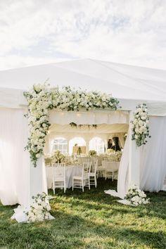 Elegant floral covered tent: http://www.stylemepretty.com/maryland-weddings/baltimore/2016/03/24/classic-elegant-maryland-horse-farm-wedding/ | Photography: Shannon Michele - http://shannonmichelephotography.com/