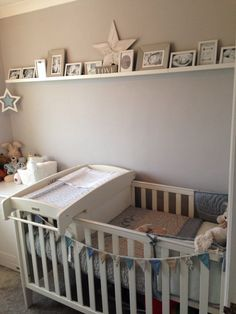 My little boys nursery. Mamas and papas, Millie and boris bedding. Picture shelf with new born shoot pictures. Star theme.