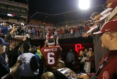 Oklahoma's Baker Mayfield (6) celebrates with fans after a college football game between the Oklahoma Sooners (OU) and the TCU Horned Frogs at Gaylord Family-Oklahoma Memorial Stadium in Norman, Okla., Saturday, Nov. 11, 2017. Photo by Bryan Terry, The Oklahoman