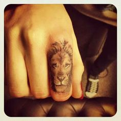 Another amazing mini animal finger tattoo.
