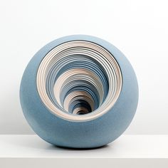 Usually people describe staring at a spinning pottery wheel as being somewhat hypnotizing, not staring at ceramic artworks themselves. But such is the case with these uncanny pieces by Matthew Chambers (previously) who continues to push the limits of his concentric stoneware vessels. Every visible l