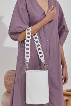 Roxanne shoulder bag is handmade of high-quality calf leather that comes in white, nude (nubuck), black, camel (waxed tan) and blue (nubuck). It features our signature chain strap in two sizes, short to use as a tote or long to wear it cross-body. Roomy enough yet elegant will hold your daily essential in style. Greek Chic Handmades Women's bags are designed and handcrafted in Athens, Greece from the same premium leather we built the sandals with and the impeccable local craftsmanship. White Shoulder Bags, Leather Shoulder Bag, Black Leather Bags, Calf Leather, Bohemian Style, Black Camel, Bucket Bag, Athens Greece, Women's Bags