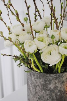 VIBEKE DESIGN - Such a striking combination with the branches, white ranunculus & aged metal bucket.