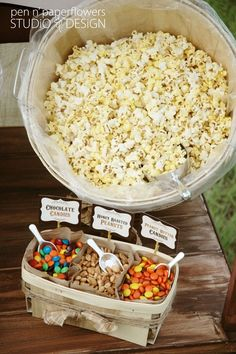 Popcorn bar... Make your own snack combo. Use paper bags to divide snacks in a basket .
