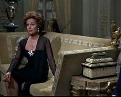 Susan Hayward? ... on the Knole sofa.   (thanks Penelope Bianchi board)