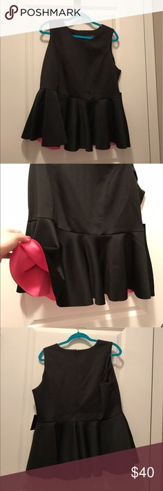 "NWT Eloquii black and pink peplum size 20 NWT Eloquii black and pink peplum size 20. Shoulder to bottom 27"". Under arm to bottom 17"". Eloquii Tops Tank Tops"