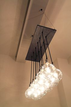 Urban Chic Chandelier with reclaimed wood. $368.00, via Etsy.