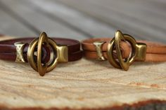 This minimalist but yet chic leather bracelet has been made with very high quality 5mm leather from Italy in chocolate brown or light brown. The leather is supple and the patina on the brass toggle gives this elegant bracelet a vintage look. This bracelet is very delicate and will complement a pair of jeans and a t-shirt or a more sophisticated outfit. Shop at www.alexille.etsy.com.  Follow Alexille on Facebook and Instagram and Pinterest @Alexille and visit my web site at www.alexille.com