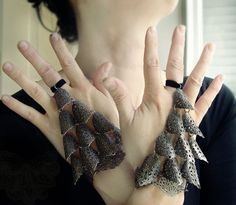 Individually forged filigree scale half gloves.    Black elastic velvet used as a ring band and again at the wrist and has adjustable chain and