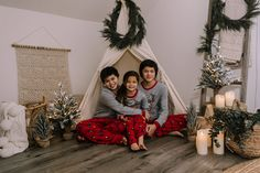 holiday mini session photo shoot christmas pajamas siblings neutral teepee greenery garland candles tree lights ladder reindeer Holiday Mini Session, Christmas Mini Sessions, Christmas Minis, Christmas Pajamas, Greenery Garland, Tree Lighting, Boudoir Photographer, Siblings, Hanging Chair
