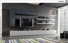 like the idea of low lying cabinet for storage and staggering tv on wall with floating shelving with additional cabinet geometrically positioned