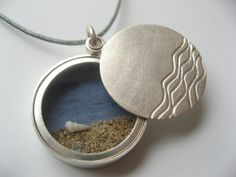 Martina Bocka-Friedl Beach Locket (sterling silver, found objects)