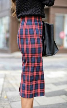The super lean fit of this pencil skirt  balances out the bright red tartan--it's all about proportion.