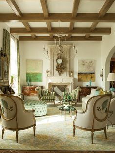 Traditional living room by Taylor & Taylor with pops of green in the artwork, upholstery & glass art accessories