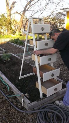 Vertical planter using old drawers