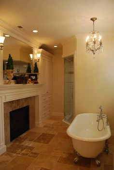 Master Bath. tub and fireplace. my dream