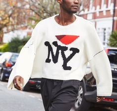 NY—and Raf Simons. Get the jumper everyone's talking about on Farfetch now.