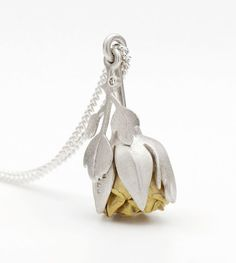 Rose Locket shown closed. Silver, 18ct gold, diamond. Photo by Paul Mounsey