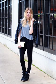 pair wedge sneakers with a motorcycle jacket