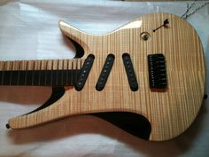 ViK guitars, nolly from RedSeasFire signature 7. Seven strings, single coils, and unusually-tilted pickups.