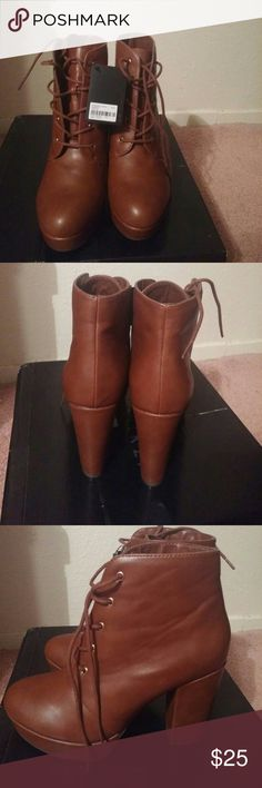 Heeled boots. They are a caramel color boots and have never been worn. Shoes Heeled Boots