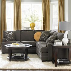 Sectional + decorative pillows, Shaggy rug ;) and I need that lamp!