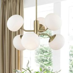 Aged Brass finish Shade Material: GLASS Backplate/Canopy: Number of bulbs: 3 Modern Floor Lamps, Modern Lighting, Lighting Ideas, Extension Dining Table, Wall Lights, Ceiling Lights, Contemporary Chandelier, Hudson Valley Lighting, Magnolia Homes