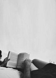 Romance couple reading lazy sunday